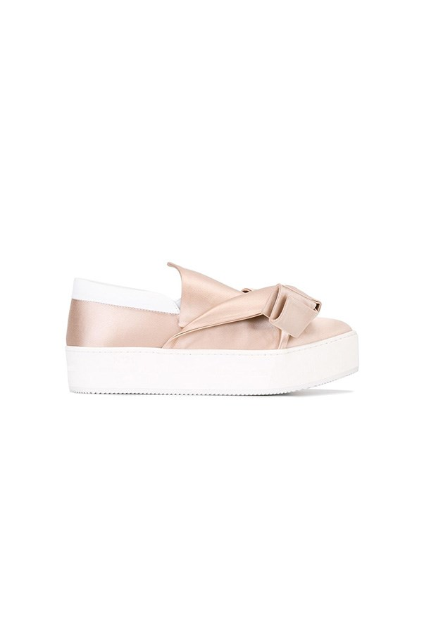 "Sneakers, $656, No. 21 at <a href=""https://www.farfetch.com/au/shopping/women/n-21-bow-detail-sneakers--item-11845552.aspx?storeid=9860&from=listing&rnkdmnly=1&ffref=lp_pic_15_7_"">Farfetch</a>"