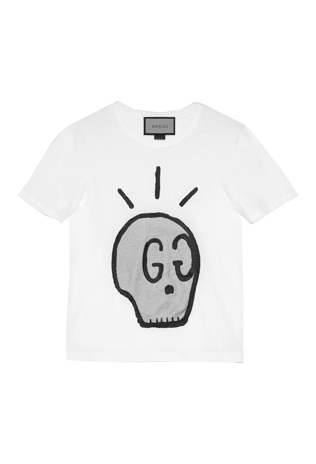"T-Shirt, approx. $587, <a href=""https://www.gucci.com/us/en/pr/men/mens-ready-to-wear/mens-t-shirts-polos/guccighost-t-shirt-p-432086X3E889616?position=12&listName=ProductGridComponent&categoryPath=Men/Mens-Ready-To-Wear/Mens-T-shirts-Polos"">Gucci</a>."