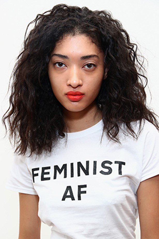 <strong>Public School</strong> <br> <br> Naturally textured hair and matte, orange-red lips is a safe but chic play.