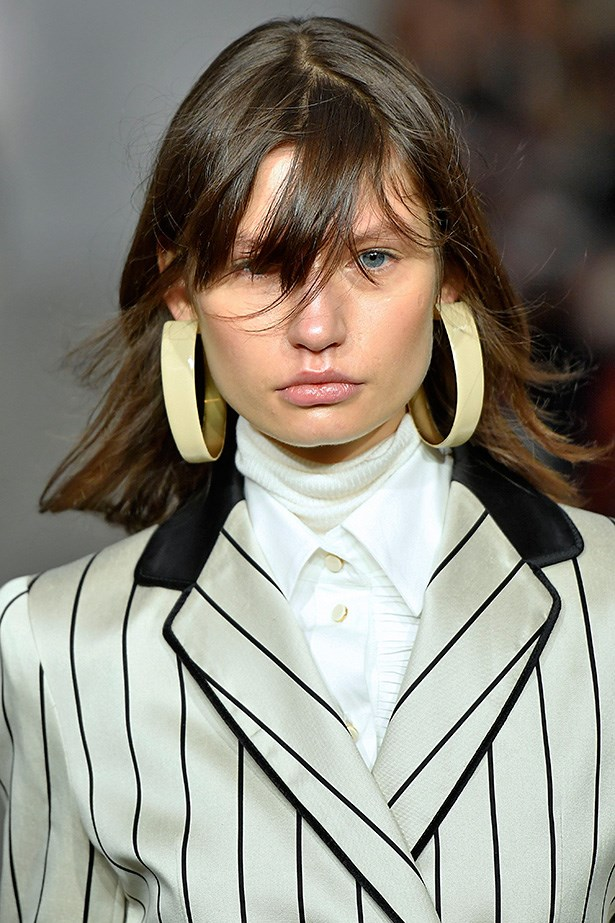 <strong>Zimmerman</strong> <br> <br> The local brand always brings a cool-girl beauty beat to New York. Fresh, lightweight fringes and highlighted skin teamed with colossal '60s hoops is exactly the kind of beauty innovation we expected from the brand.