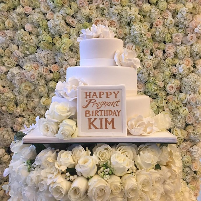 Ah ha! Kanye also deployed the flower wall at the 'pregnant birthday party' he threw Kim before the birth of their son, Saint.