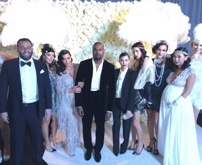 What's that we see? Another flower wall at Kris Jenner's 60th <em>'The Great Gatsby'</em>-themed party? That Kanye did himself attend? Curious INDEED.