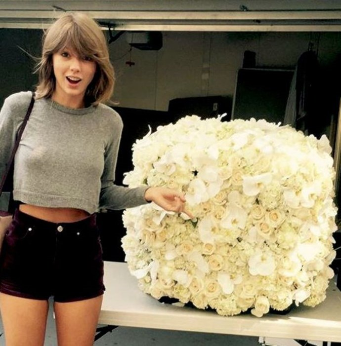 Taylor Swift is miraculously gifted with a flower cube? You don't fool us, Kanye, we know that a cube is just a wall folded into a little box.