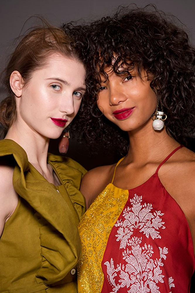 """<strong>Rosie Assoulin</strong><br> The romantic pinky-red lip at Rosie Assoulin? MAC Cosmetics' <a href=""""https://www.maccosmetics.com.au/product/13854/37620/products/makeup/lips/lipstick/retro-matte-liquid-lipcolour#/shade/Dance_with_Me"""">Retro Matte Liquid Lip Colour in 'Dance With Me</a>'."""