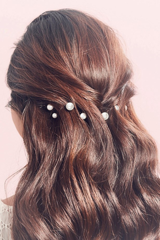 Pearl pins are the understated version of a hair circlet. Dot them  through the hair to create a pretty detail that doesn't become too dressy for day wear. <br> <br> <em>Jen Atkin X Chloe + Isabel </em>