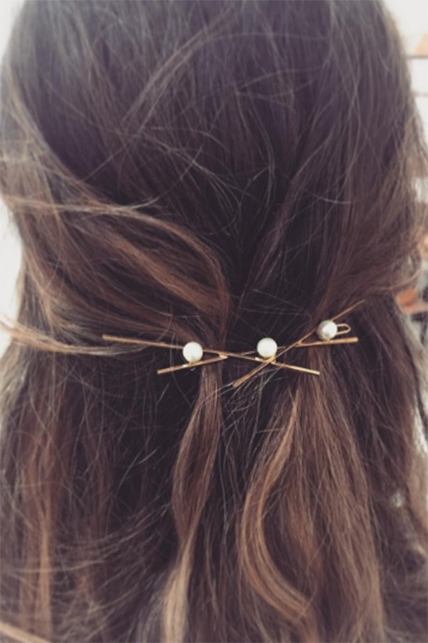 Pearls on exposed, criss-crossed gold slides is the fashion-forward girls way of doing wedding guest hair. <br> <br> <em>@LeletNY</em>