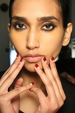<strong>Sachin & Babi</strong> <br><br> The look: The new half-moon. <br><br> The kit: For Sachin & Babi's half-moon nail look, manicurist Naomi Gonzalez applied two thin coats of Zoya nail polish in Brooklyn followed by two coats of Courtney on the top quarter of the nail.