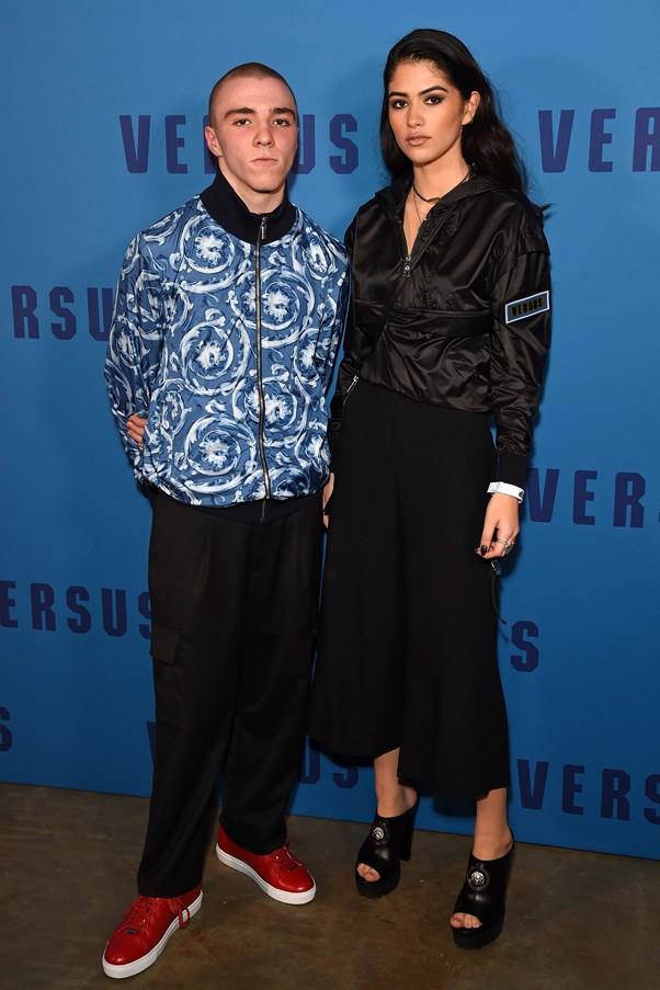 <p>Rocco Ritchie and Kim Turnbull at Versus Versace