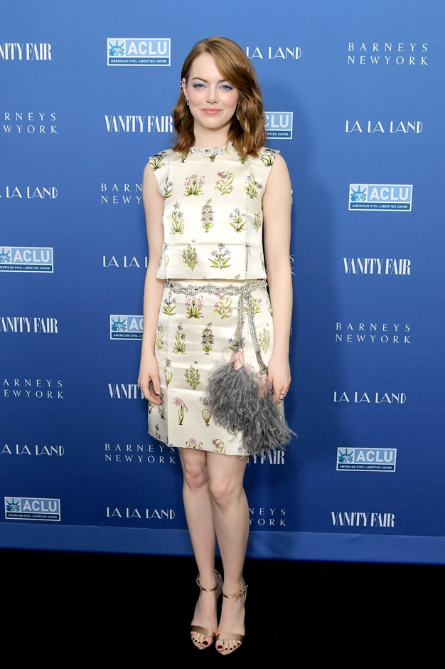 Emma attended a Vanity Fair party this week wearing a light-green Giambattista Valli ensemble with a feathered belt.