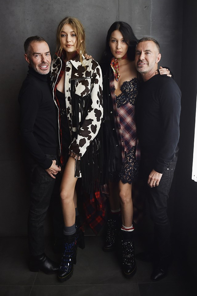 At a party for Dsquared2, Bella and Gigi both rocked slip dresses under coats, and both also wore high-heeled boots with thick socks. Chic.