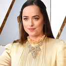 Dakota Johnson's Gucci Dress At The Oscars Is Dividing Fans image