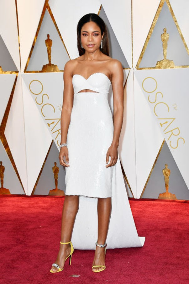 <strong>Naomie Harris in Calvin Klein By Appointment</strong> <br><br> Floor-length gowns are de rigueur for the Academy Awards, but Harris went high-low. Her white sequins were elegant and a major moment in the fashion world: It's  the first red-carpet moment from Calvin Klein since Raf Simons has had the top spot.