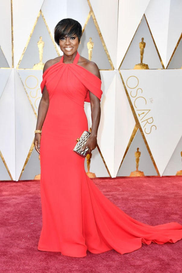 <strong>Viola Davis in Armani Privé</strong> <br><br> There was the most perfect little hint of Greek goddess in the way Davis's Armani Privé gown draped off her shoulders. She didn't take the Grecian thing too literally though: A halter neck made it feel different, and the cherry red color popped beautifully.