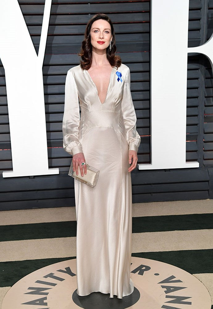 <em>Outlander</em> star Caitriona Balfe's pin stood out against her cream gown.