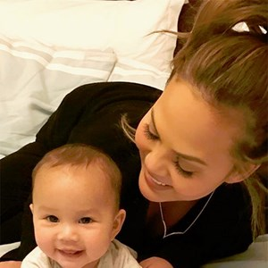 Chrissy Teigen and Luna.
