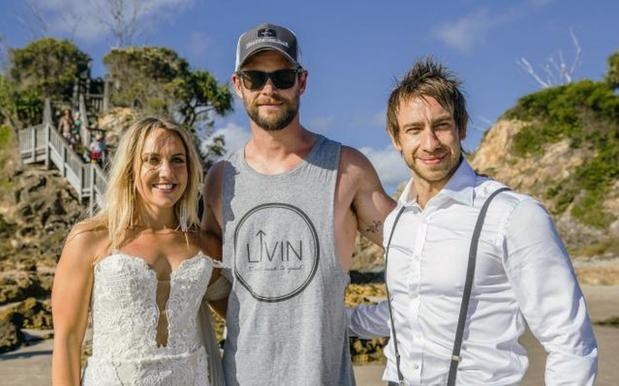 "<strong>Chris Hemsworth</strong> <p> <p> Perth couple Anneka and Kent had a wedding photoshoot by the beach in Byron Bay over the weekend. Little did they know that Chris Hemsworth (who lives in the area) was having a surf nearby and happily got involved with the couple's shoot. ""It was Chris Hemsworth on the beach and he was like, 'Hey, do you think you could get a photo with the bride and groom?' And he said, 'No worries,'"" Anneka told <a href=""http://news.com.au""><em>news.com.au.</em></a>"
