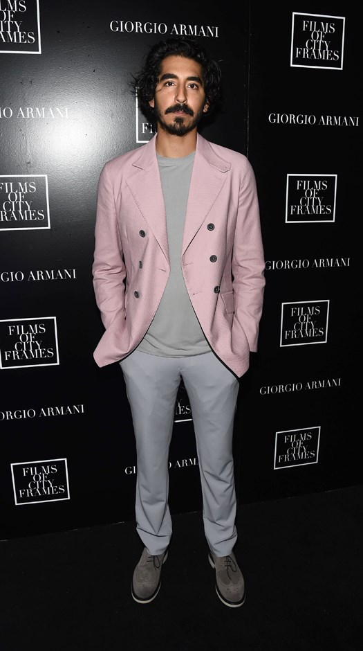 Attending the Films Of City Frames premiere at SXSW, Dev wore this all-heather grey outfit, topped with a double-breasted pink blazer. Chic.