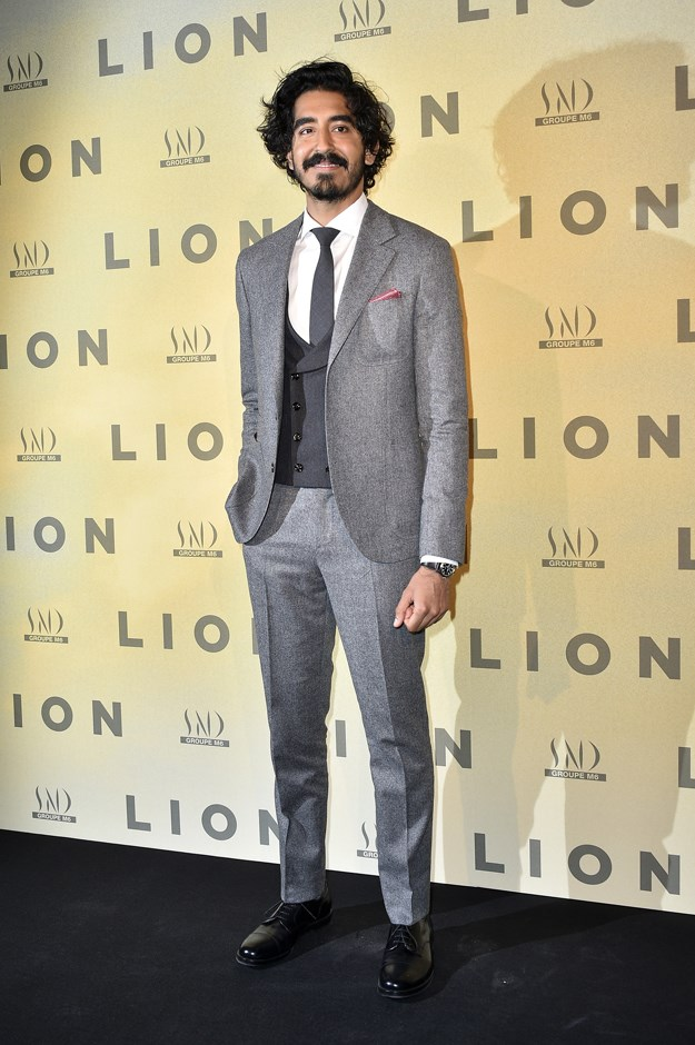 We love the detail on Dev's three-piece suit.