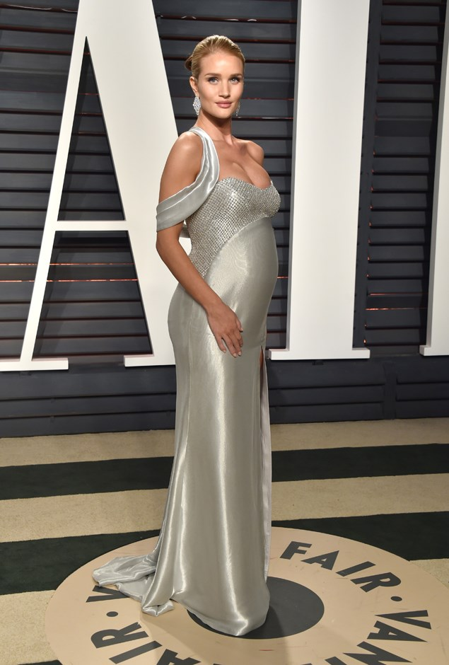 Attending the <em>Vanity Fair</em> Oscars party, Rosie wore this gorgeous silver gown by Atelier Versace.