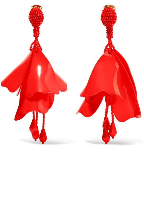 "<p>Oscar De La Renta earrings, $682 at <a href=""https://www.net-a-porter.com/au/en/product/848439/oscar_de_la_renta/large-impatiens-resin-clip-earrings?cm_mmc=LinkshareUK-_-TnL5HPStwNw-_-Custom-_-LinkBuilder&siteID=TnL5HPStwNw-HirYzYKSwJuMtGVx_K53DQ&Skimlinks.com=Skimlinks.com"">Net-a-Porter</a>"