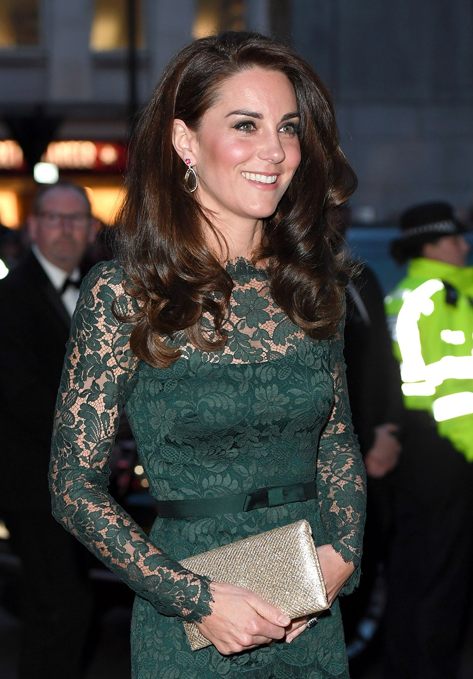 She paired the dress with gold accessories—a Wilbur & Gussie clutch and Jimmy Choo shoes—and a matching green pair of Kiki McDonough earrings. Chic.