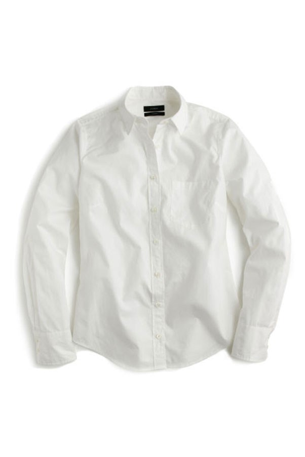 """<strong>2. The White Button-Down</strong> <p><p> Lyons taught us how to make a plain white button down look cool. Can you imagine having to wear your sleeves worn all the way down, without the J. Crew roll and tuck? She helped us realize that this wardrobe staple goes with everything: denim, tulle skirts, and anything in between. <p><p> J. Crew New Perfect Shirt, $121 AUD; <a href=""""https://www.jcrew.com/au/p/womens_category/shirtsandtops/casualshirts/new-perfect-shirt-in-cotton-poplin/E9376?srcCode=AFFI00005&siteId=TnL5HPStwNw-DH194u2pxaUjZbNq_YMjKg"""">jcrew.com</a>"""