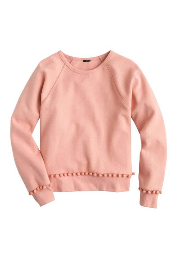 """<strong>6. Elevated Sweatshirts</strong> <p><p> Love it or hate it, J. Crew mainstreamed the idea of sweats for non-athletic purposes. Whether your participation in athleisure is as advanced as a Hadid sister or you just prefer to spend your Sundays in leggings, you can thank Lyons, in part, for your newly cozy life. Under her creative direction J.Crew paired joggers with stilettos and added pom-poms to crewnecks. <p><p> Pom-Pom Sweatshirt, $103 AUD; <a href=""""https://www.jcrew.com/au/p/womens_category/sweatshirtssweatpants/sweatshirts/pompom-sweatshirt/G5504?srcCode=AFFI00005&siteId=TnL5HPStwNw-0A68bzeh86StekYM6NGhCQ"""">jcrew.com</a>"""