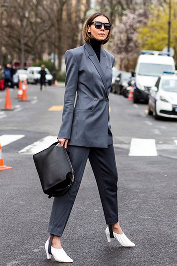 <strong>3. The Power Suit</strong> <br></br> Don a turtleneck and fasten your jacket for important meetings.