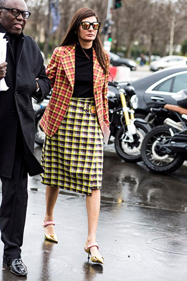 <strong>4. The Statement Midi-Skirt</strong> <br></br> Throw on a blazer and a pair of kitten heels for during the day.