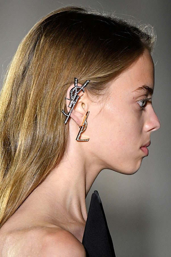 Saint Laurent, Dior and Loewe are among the fashion houses bringing back the logo mania of the 2000s via statement earrings. Here, 10 to shop now.