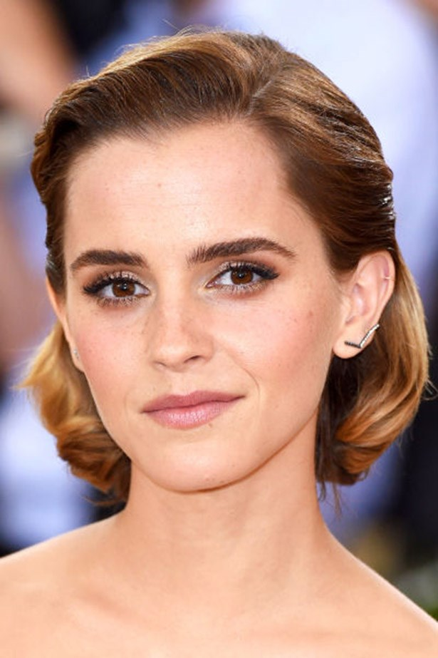 <strong>Emma Watson</strong> <br><br> Side parted, slicked back <em>and</em> curled under, Emma Watson's bob is a sculptural feat.
