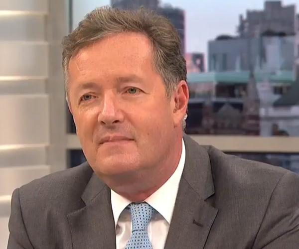 Watch Piers Morgan look on joylessly as his coworker roasts him