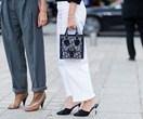Rihanna And Bella Hadid Are Bringing Back Those Noughties Dior Logo Bags