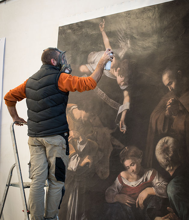 A member of Factum Arte works on a print of Caravaggio's nativity