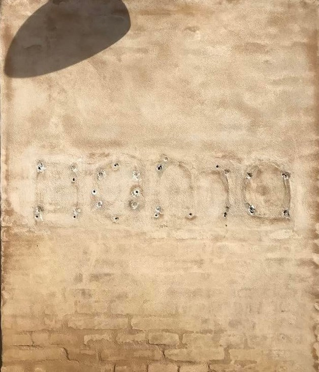 Marks left behind after the removal of Noma's signage