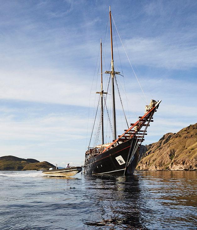A dinghy ferries supplies from Amandira