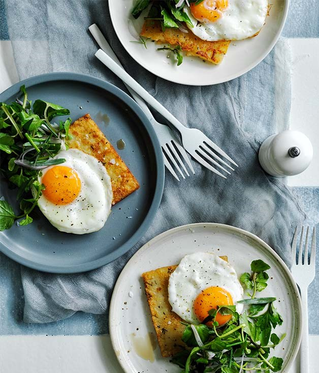 Hash browns with eggs fried in olive oil and herb salad recipe ...