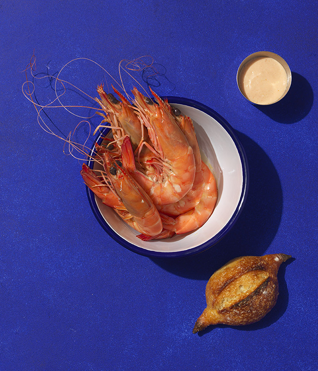 Bucket of prawns with bread and cocktail sauce