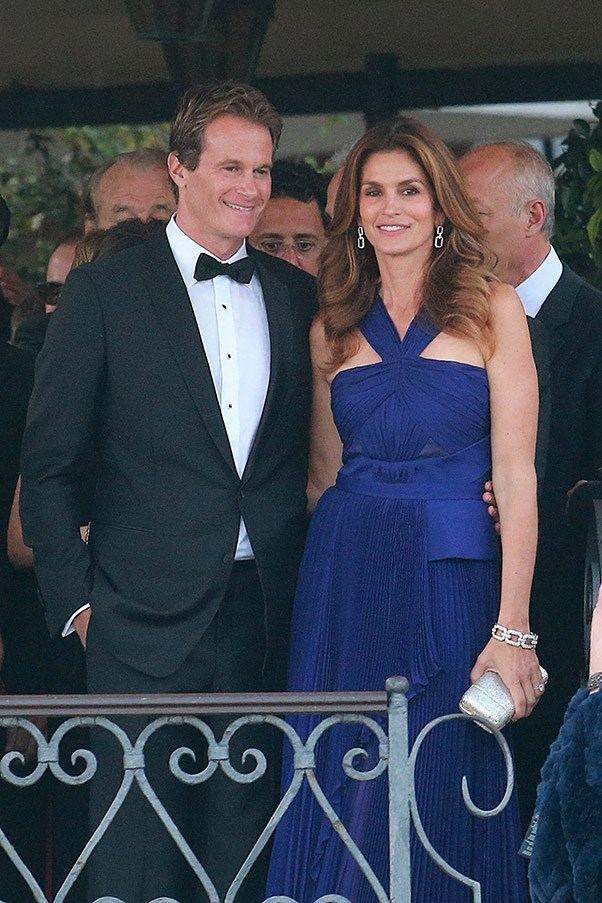 Cindy Crawford, pictured here with husband and Clooney's best man Rande Gerber, chose a cobalt blue gown for the big day.