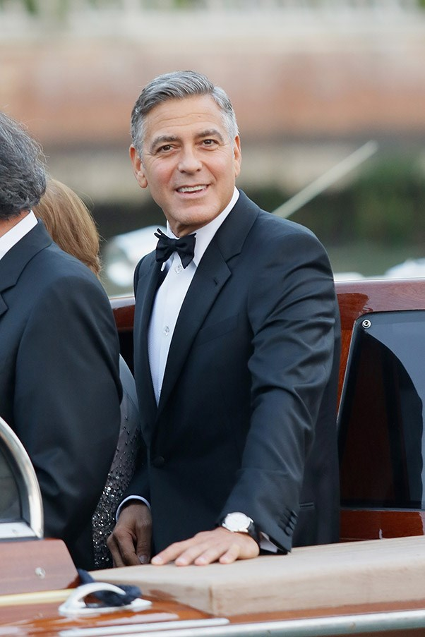 Clooney, pictured here on his way to the wedding, wore an Armani suit.