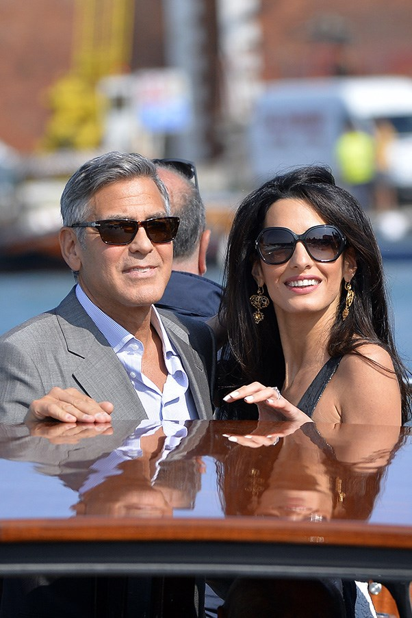 Clooney and Alamuddin take in the sights of Venice the day before their wedding.