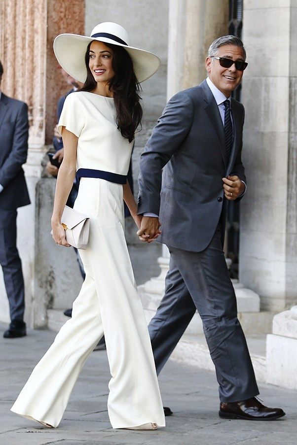 Clooney and Alamuddin stepped out in Venice on Monday, with the gorgeous British barrister opting for a two-piece bespoke cream top and trousers with an off-white box clutch, all by Stella McCartney.