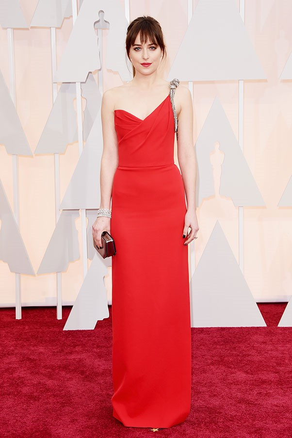 <strong>SAINT LAURENT</strong><BR><BR> Dakota Johnson at the Academy Awards