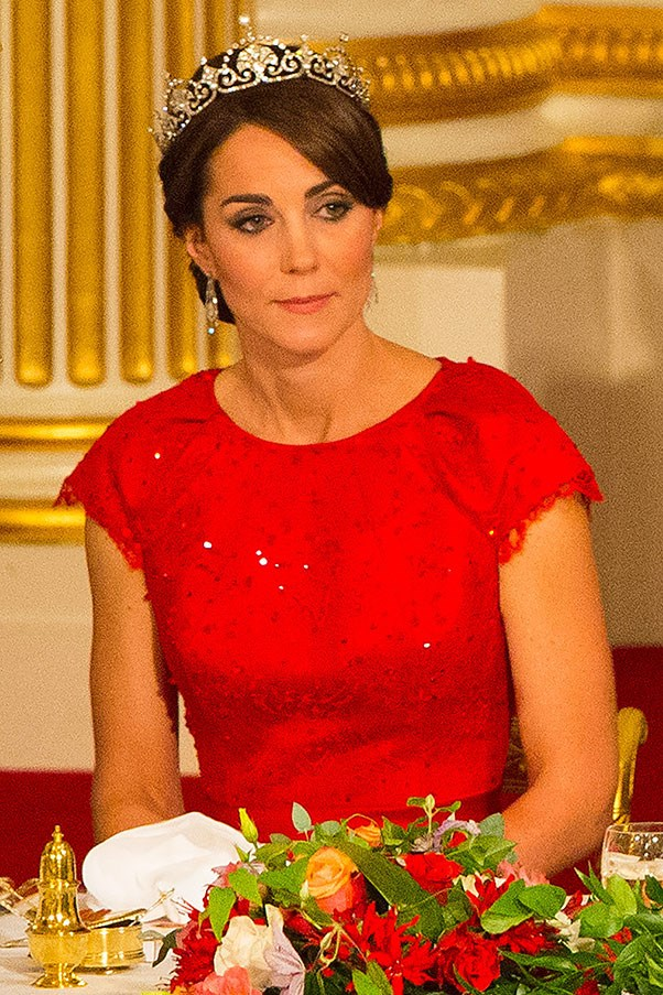 "Kate donned a tiara for only the third time ever, to attend the China State Dinner at Buckingham Palace. The ""Lotus Flower"" tiara was a favourite of Princess Margaret, which Kate paired with a red Jenny Packham gown."