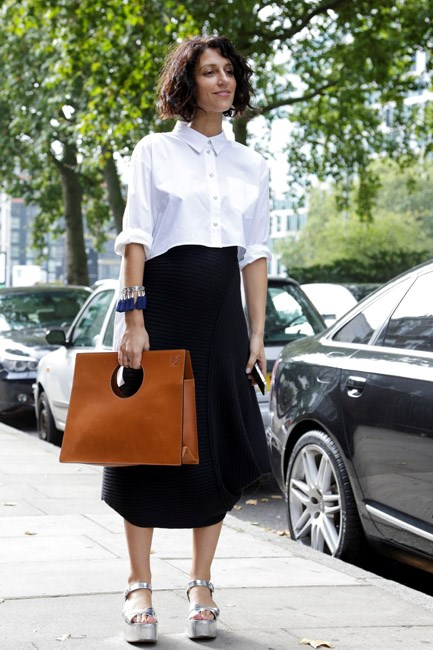 If in doubt, there's not much a classic white shirt and black midi skirt can't fix.