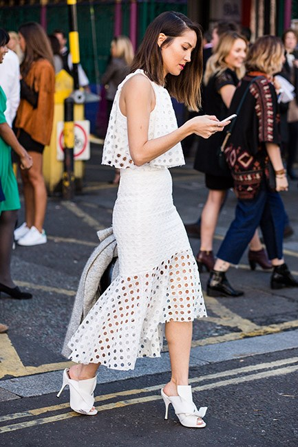 Add interest to an all-white ensemble via graphic details and sculptural shoes.