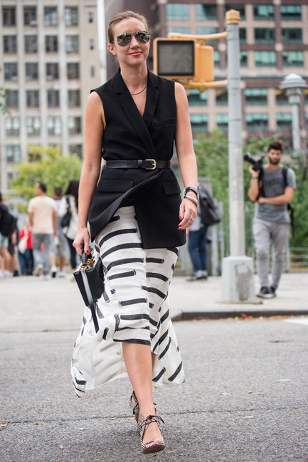 Turn that sleeveless jacket into a tunic top by cinching with a belt. Corporate, but still cool.