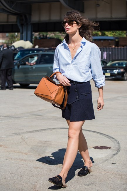The contrast between the mannish button down and the girly A-line skirt gets us every time. Team with a slip-on loafer (Gucci, preferably) and you're good to go.