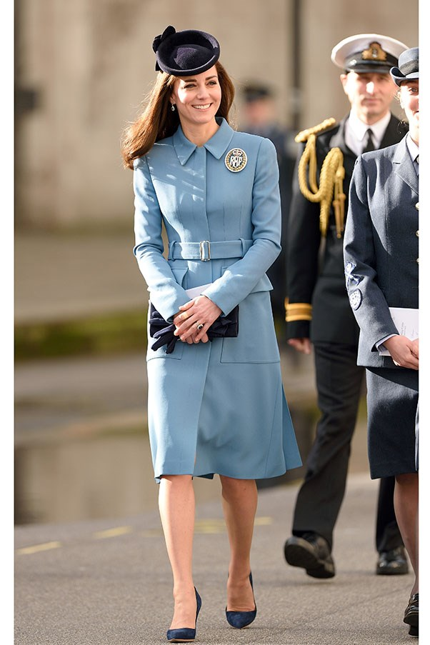 "The Duchess steps out in her signature coat dress silhouette pairing a blue bespoke Alexander McQueen coat with <a href=""http://www.rupertsanderson.com/"">Rupert Sanderson</a> navy suede 'Malory' pumps."
