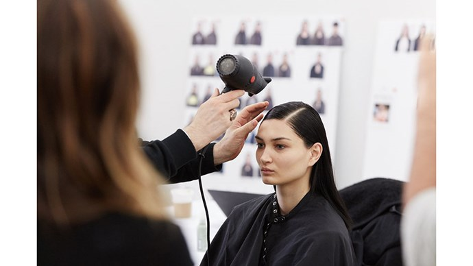 Aveda Hair Director Jon Reyman at our beauty test. The hair look for this season is a masculine side part and low released ponytail, creating a natural kink.